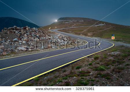 Transalpina Road At Dusk, Highest And Most Dangerous Asphalt Road.