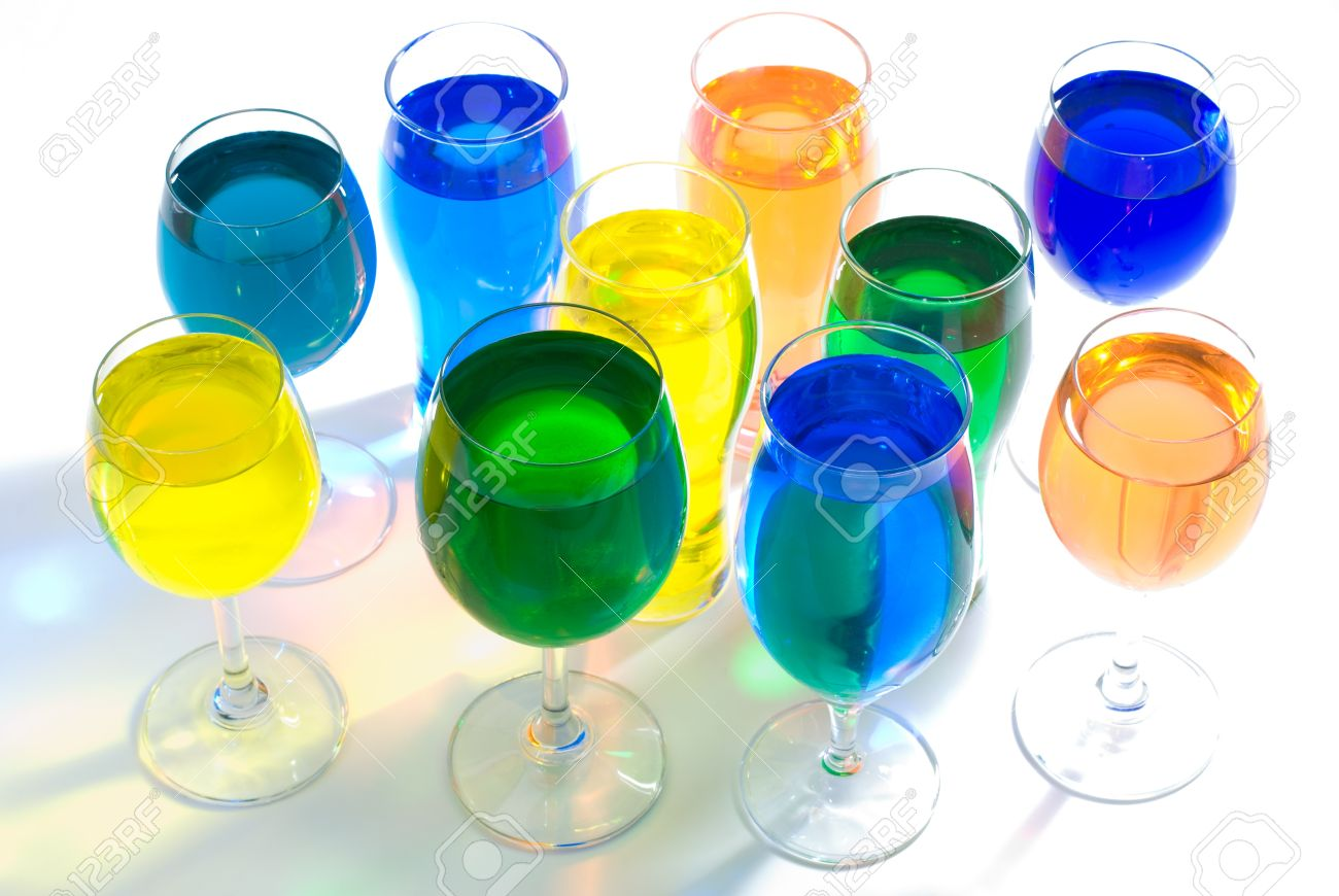 Set Of Several Wine Glass And Color Water With Color Transmitted.