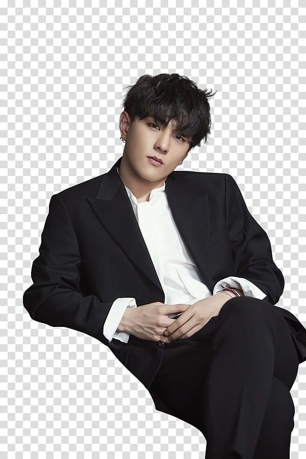 IKON NAVER P, sitting man wearing black suit jacket.
