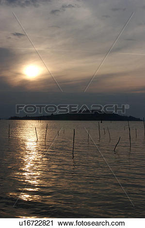 Stock Photography of Lake Trasimeno view of island at sunset.