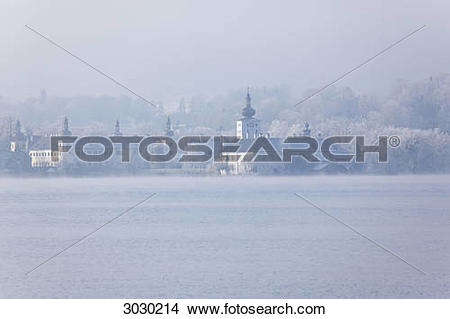 Stock Photo of Traunsee and Castle Ort in foggy weather, Gmunden.