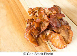 Pictures of Black fungus or tree ear mushroom on wood background.