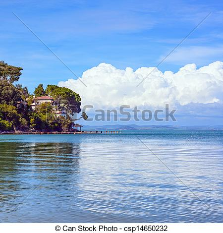 Stock Photos of Headland, trees, and pier or jetty on a blue ocean.