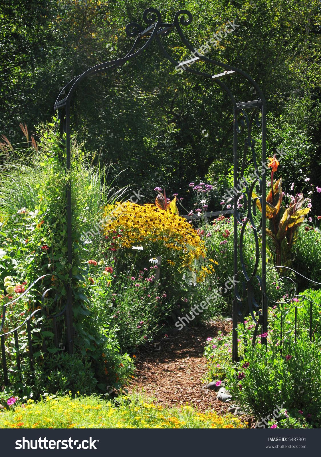 Wrought Iron Trellis Arch To Secret Garden Stock Photo 5487301.