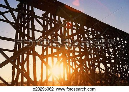 Stock Photo of Trestle bridge at sunset x23295062.