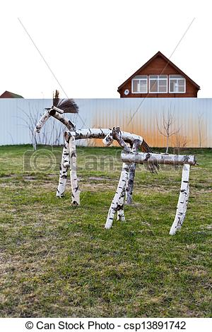 Stock Photo of wooden trestles on backyard of coutry village in.