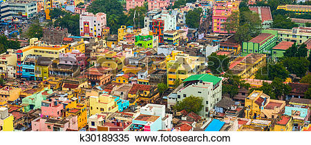 Stock Image of cityscape of colorful homes in crowded Indian city.