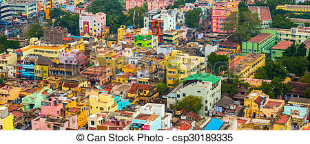 Stock Photos of cityscape of colorful homes in crowded Indian city.