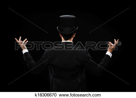 Stock Photography of magician in top hat showing trick from the.