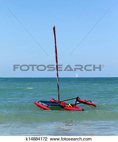 Stock Photo of Small trimaran with sail k14884172.