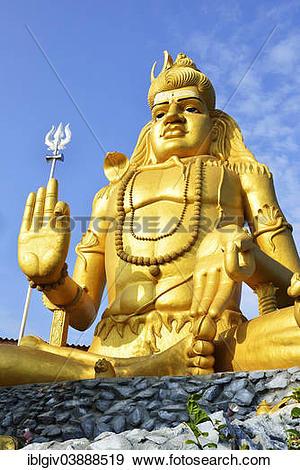 "Stock Photograph of ""Golden Shiva statue in Hindu Shiva temple."