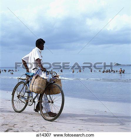 Picture of Sri Lanka, Trincomalee, local man selling sea shells.