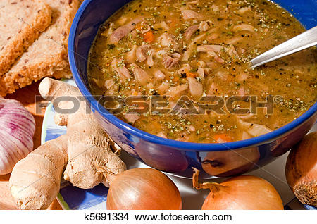 Stock Photo of Traditional tripe soup in blue pottery k5691334.