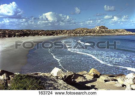 Stock Photo of Waves on coast, Leptis Magna, Tripoli, Libya 163724.
