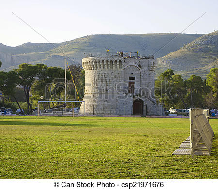 Picture of Trogir, Sr. Mark tower and green field.