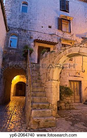 Stock Photography of archway and house in old town of Trogir at.