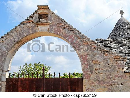 Stock Photographs of Farm with rusty gate and trulli house with.