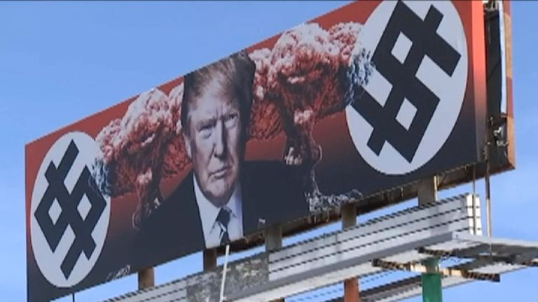 Row over Trump billboard with \'swastika dollar signs.