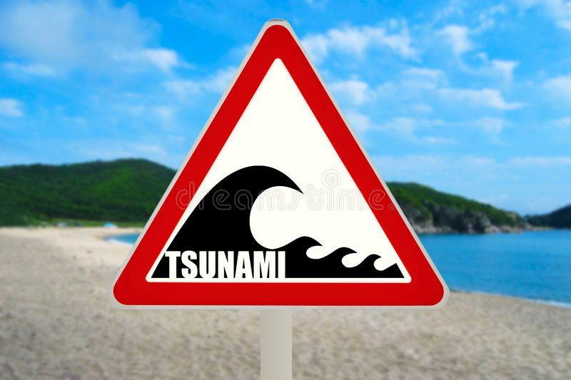 Tsunami Warning Sign. Tsunami hazard zone sign on the beach.
