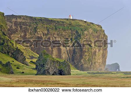 "Stock Photo of ""Tuff rock with a lighthouse, Dyrholaey, Vik i."