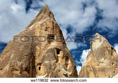 Stock Photo of Eroded tuff rock with access openings to storage.