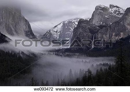 Stock Photo of Clearing winter storm with clouds and fog in.