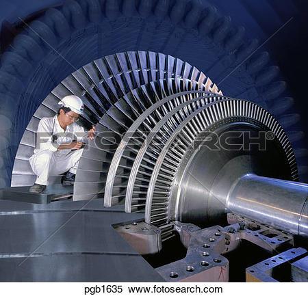 Stock Image of Hong Kong, China. Engineer setting up turbine rotor.