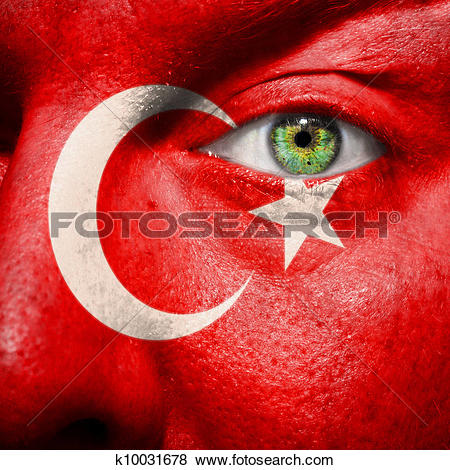 Pictures of Flag painted on face with green eye to show Turkey.
