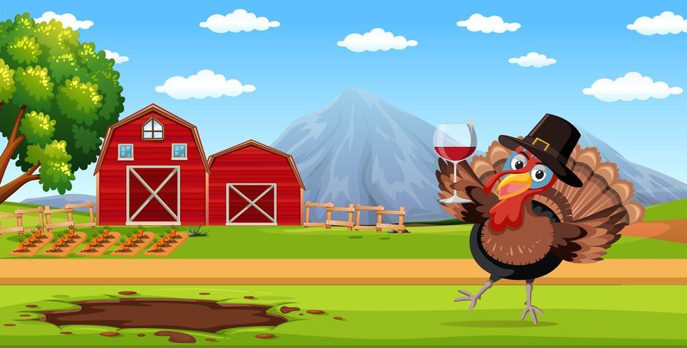 Turkey holding wine glass in farm scene.