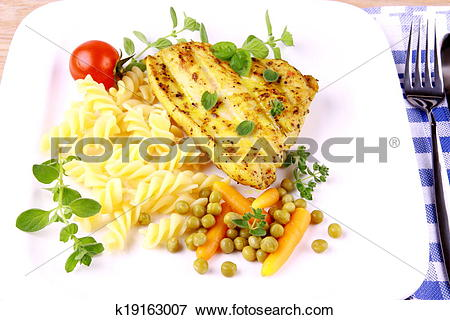 Picture of Grilled turkey steak with noodles peas, carrots, tomato.