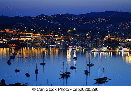 Stock Photographs of View of Gumbet Bay by night. Turkish Riviera.
