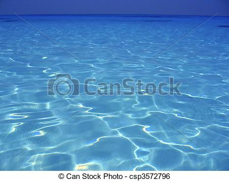 Stock Image of Caribbean sea blue turquoise water in Cancun Mexico.