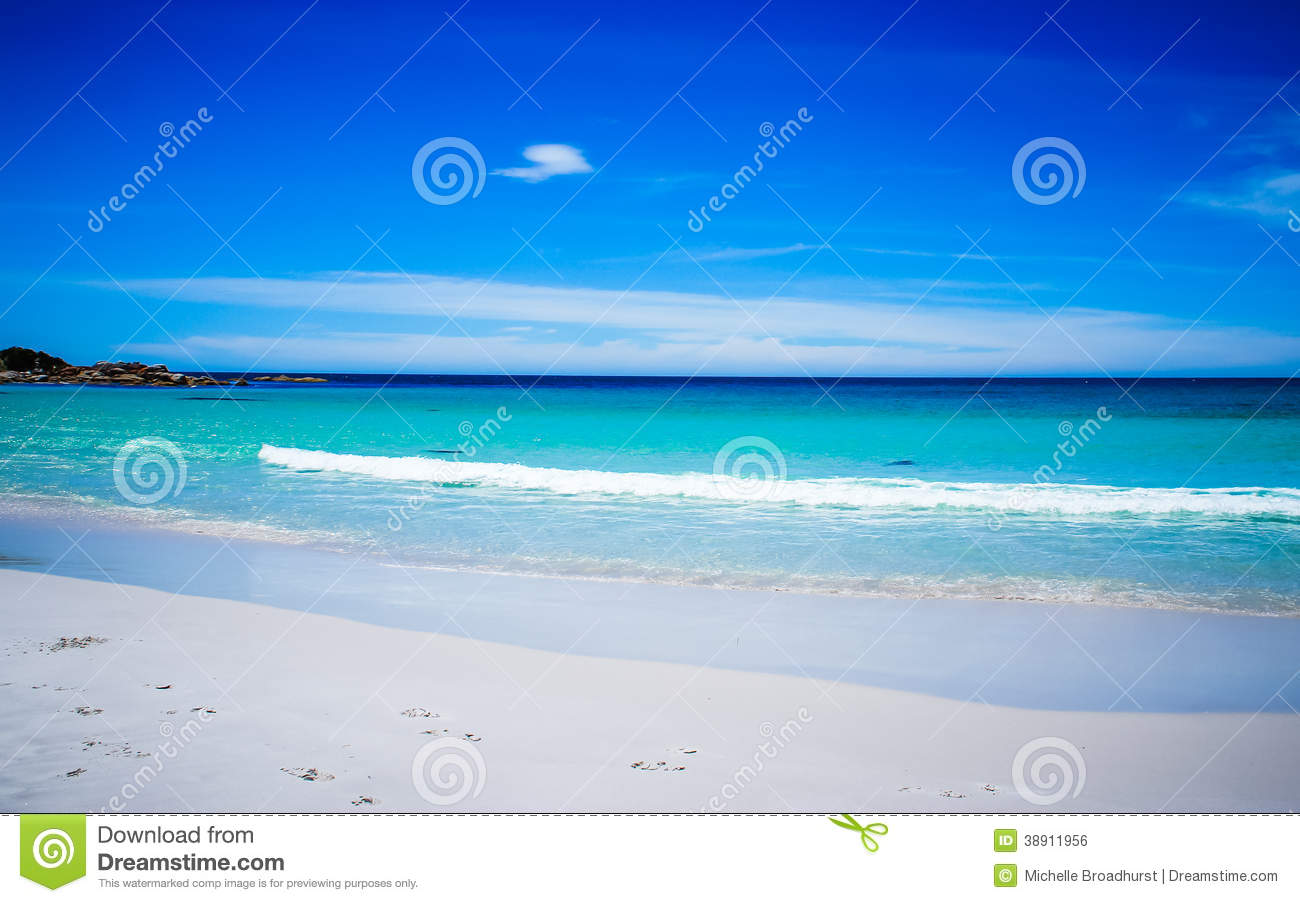 Beach Scene With White Sand And Turquoise Water Stock Photo.