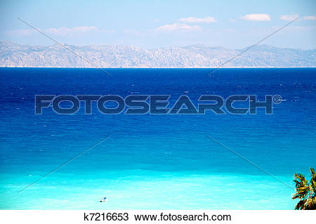 Stock Photo of Clear turquoise water at Aegean seaside k7216653.