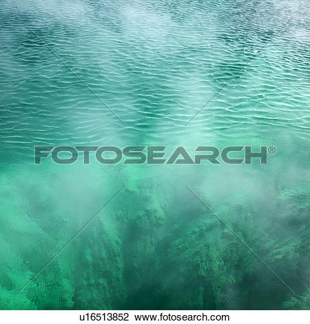 Stock Photo of Pool of steaming turquoise water u16513852.