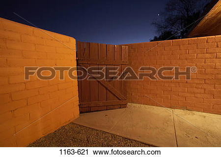 Stock Photography of Gate left ajar at night, Twentynine Palms.