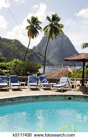 Stock Photography of Caribbean Sea resort swimming pool view twin.