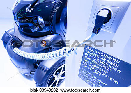 "Stock Photo of ""Electric car charging with a charging cable."