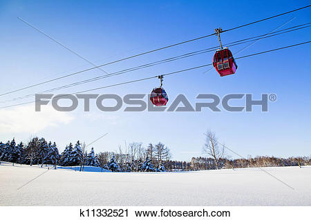 Stock Photography of two red cable car in winter k11332521.