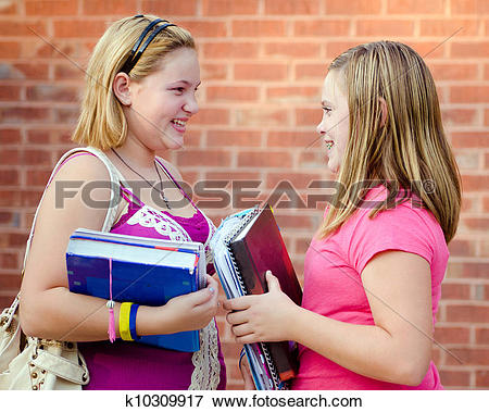 Picture of Two adolescent or teen girls talking outside school.