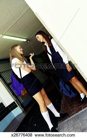 Pictures of low angle view of two school girls talking in a.