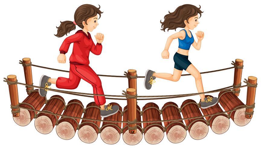 Two girls running on the wooden bridge.