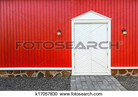 Stock Photography of Red wooden wall and white front doors with.