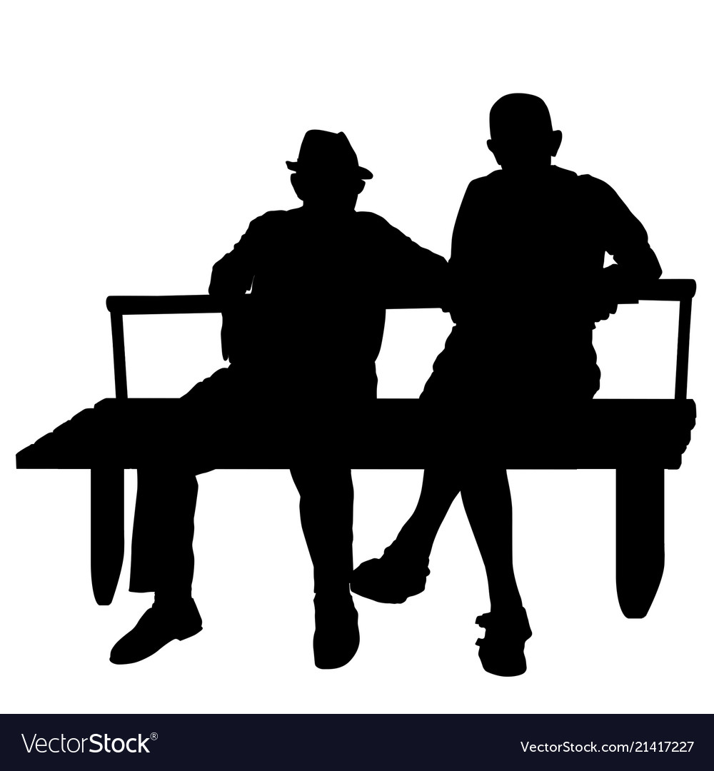 Two elderly people silhouettes sitting on a park.
