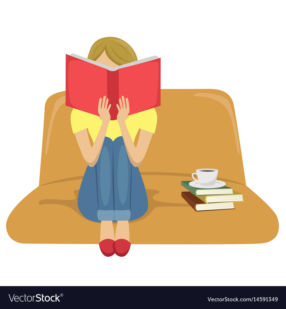 Young woman reading book sitting on sofa.