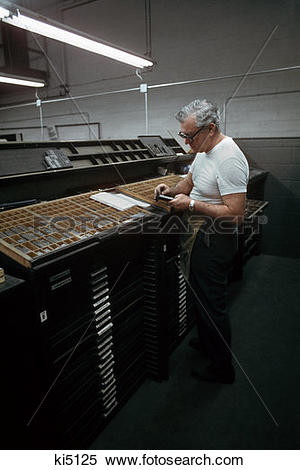 Stock Image of 1960S Man Typesetter Setting Printing Type By Hand.