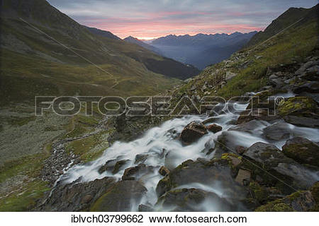 "Stock Photo of ""A mountain stream waterfall at sunrise, Kappl."