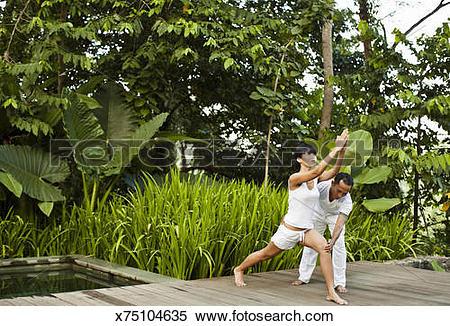 Stock Image of Woman practices yoga at Kayumanis Ubud, Bali, Indo.