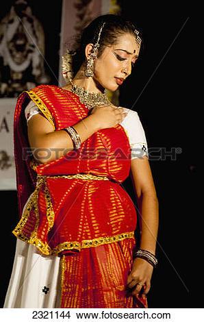 Stock Photo of India, Karnataka, Young Girl Dancing In Traditional.