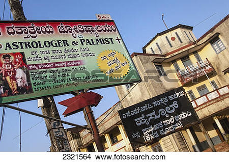 Stock Photo of India, Karnataka, Commercial Sign For Astrologer.